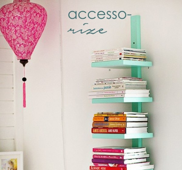 Use bright bookshelves to accessorize with colour in a neutral room.