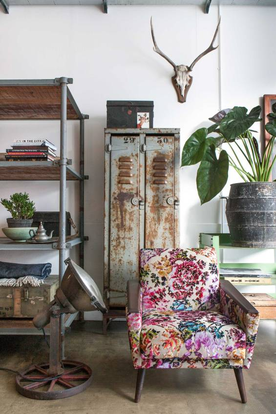 Beautifully busy floral print chair makes a statement in this rustic room.
