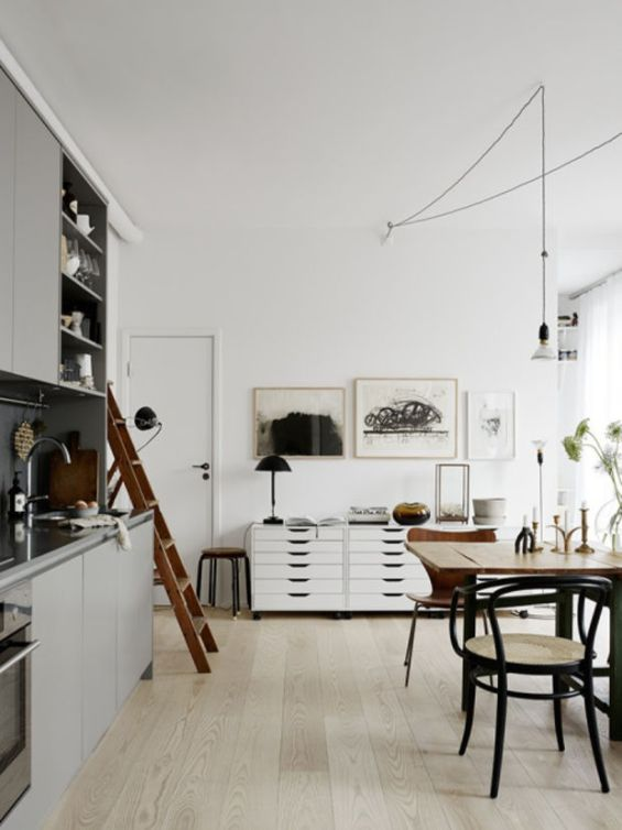 A few black elements with light floors and walls