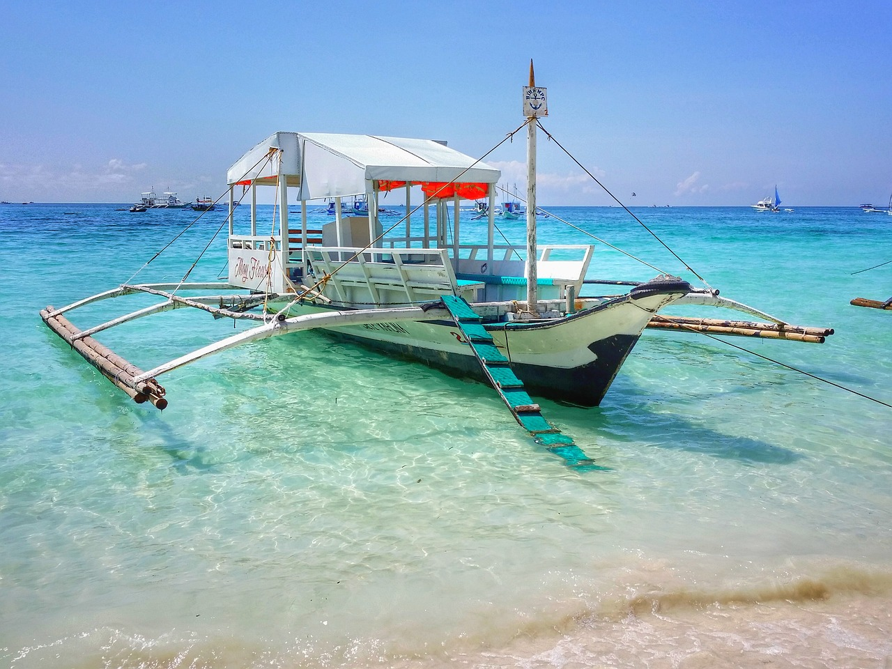 Chartering a boat and exploring is the way to romance in Boracay.