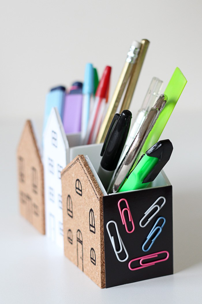 Small square of adhesive magnet sheet to stick to the side of your desk organiser.