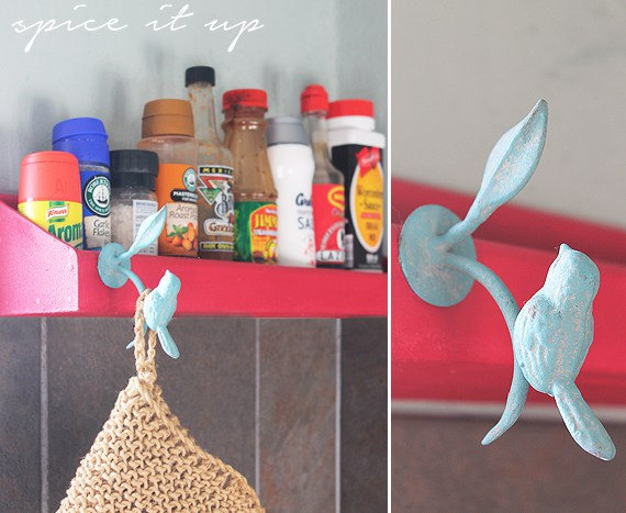 Little bird accent on the red spice rack look great with the colour scheme of the kitchen.
