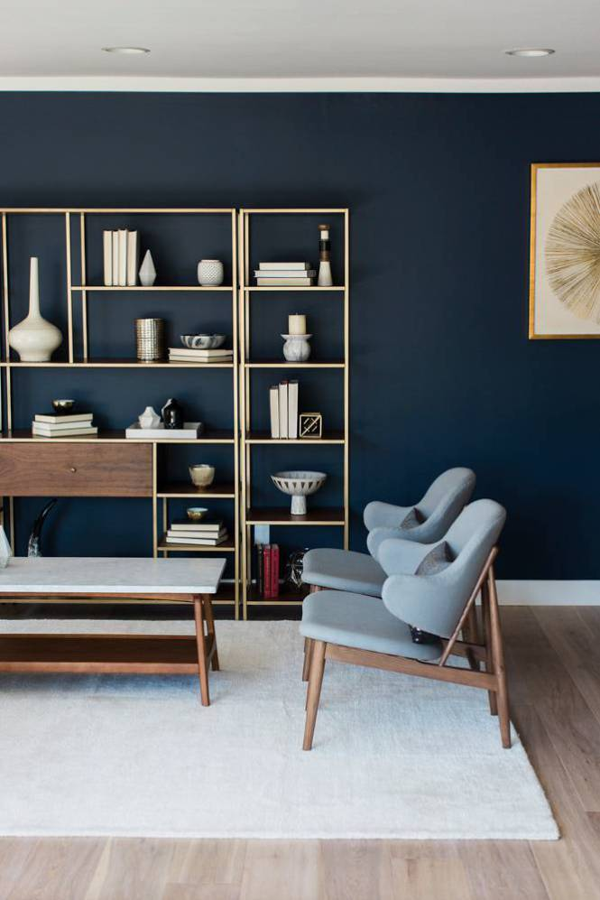 Gold shelving against dark background