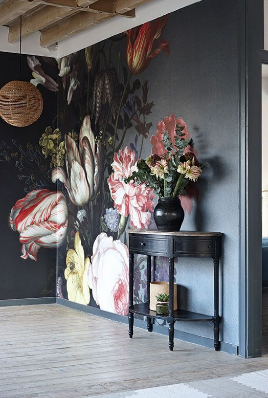 Break up a black wall with a bold floral print.