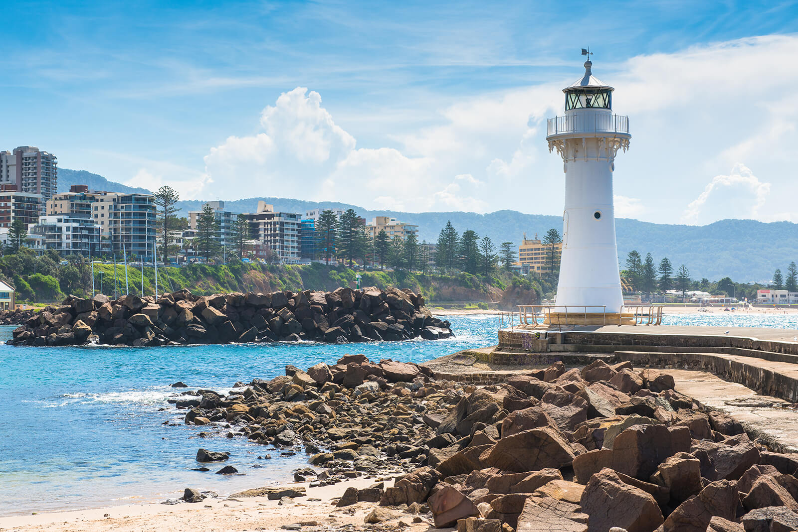 Lighthouse in Wollongong with ocean and city in the background.