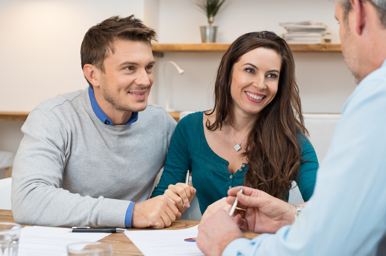 Couple meeting a mortgage broker to refinance