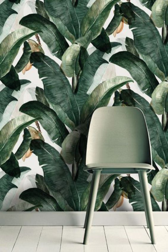 Trocial paradise wallpaper accessorized with a moss-green chair