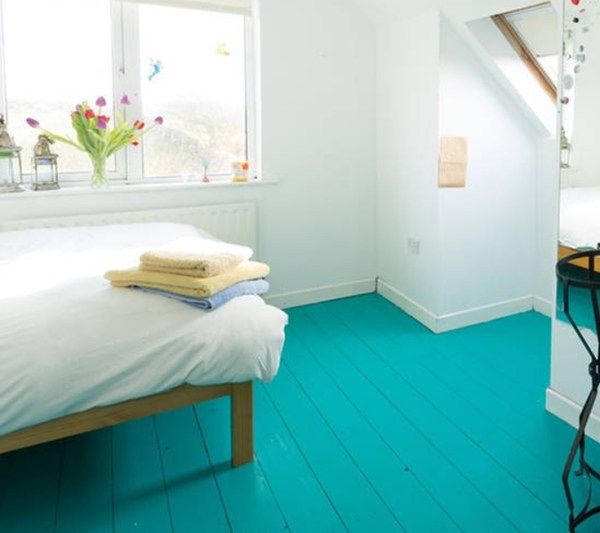 Painting the floor is a great way to add colour without taking up lots of space.
