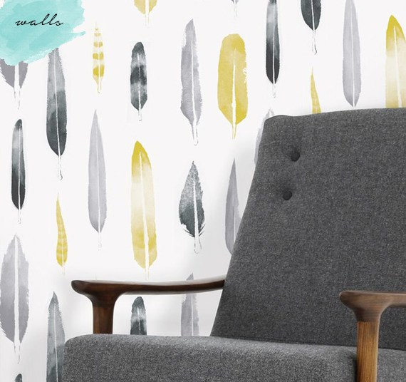 Wallpaper with printed feathers that have a watercolour feel