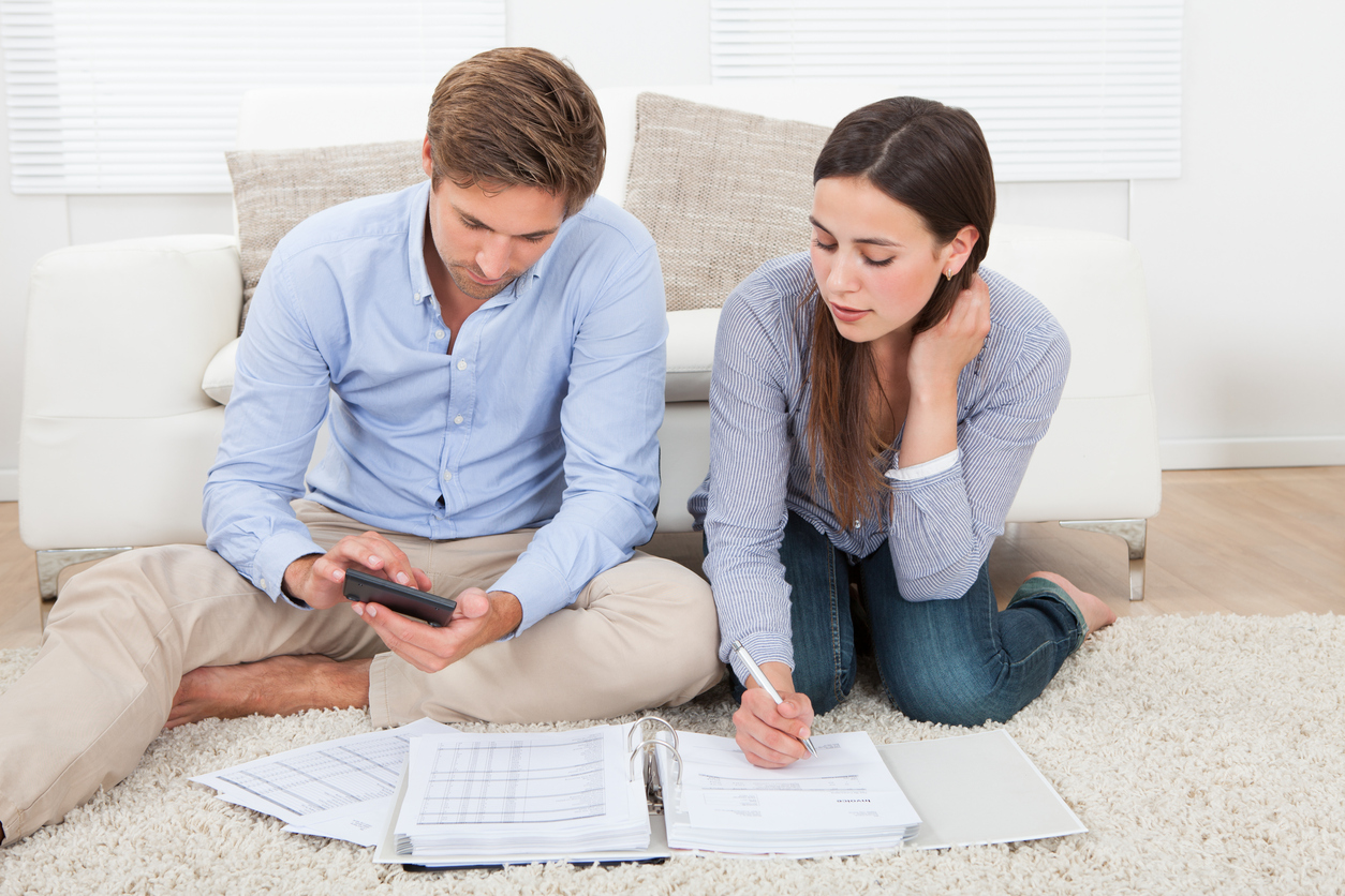 Young couple saving for a deposit
